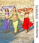 Beautiful belly dancers on the ancient stairs of Kourion amphitheatre in Cyprus. - stock photo