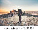 man with backpack hiking in... | Shutterstock . vector #570715150