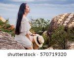 beautiful girl in white dress...   Shutterstock . vector #570719320