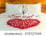 Stock photo beautiful hotel for honeymoon sweet swan couple put on honeymoon bed look like heart shape with 570727549
