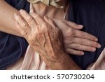old and young person holding... | Shutterstock . vector #570730204