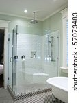 luxurious shower in black and white tile with glass walls - stock photo