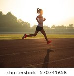 young woman running during... | Shutterstock . vector #570741658
