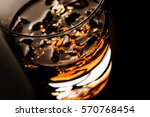 glass of whiskey isolated on... | Shutterstock . vector #570768454