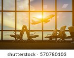 Small photo of passenger seat in Departure lounge for see Airplane, view from airport terminal.sun light in vintage color selective focus,transport and travel concept