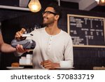 man using mobile payment in a... | Shutterstock . vector #570833719