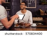 people using technology in a... | Shutterstock . vector #570834400