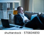 businessman in suit lying on a... | Shutterstock . vector #570834850