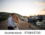 happy bride and groom hugging... | Shutterstock . vector #570843730