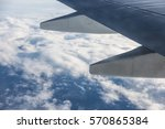 wing of an aircraft and cloudy... | Shutterstock . vector #570865384
