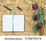 Wilted Roses With A Notebook...