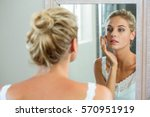 reflection of woman checking... | Shutterstock . vector #570951919