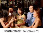men and women at bar | Shutterstock . vector #570962374