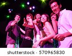 Young Adults At Night Club ...
