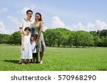 family of four standing in... | Shutterstock . vector #570968290