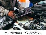 auto mechanic repairing car.... | Shutterstock . vector #570992476