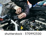 auto mechanic repairing car.... | Shutterstock . vector #570992530