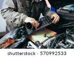auto mechanic repairing car.... | Shutterstock . vector #570992533