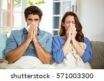 young couple blowing their nose ... | Shutterstock . vector #571003300