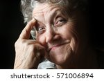 thoughtful grandmother | Shutterstock . vector #571006894