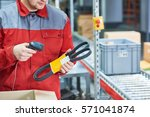 warehouse worker scanning... | Shutterstock . vector #571041874