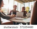 happy friends using laptop... | Shutterstock . vector #571054480