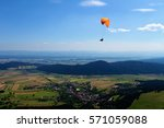 Paraglider Flying Above A...