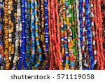 strands of small colorful beads ... | Shutterstock . vector #571119058