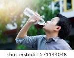 man drinking water from bottle. | Shutterstock . vector #571144048