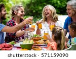 happy family toasting drinks... | Shutterstock . vector #571159090