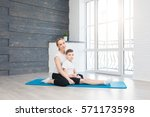 fitness mother with her 9 years ... | Shutterstock . vector #571173598