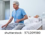 senior man having stomach pain... | Shutterstock . vector #571209580