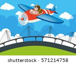 pilot flying plane over the...