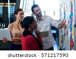 team of colleagues standing by... | Shutterstock . vector #571217590