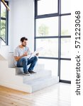 man on steps having cup of...   Shutterstock . vector #571223068