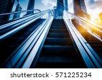 escalator with cityscape in... | Shutterstock . vector #571225234