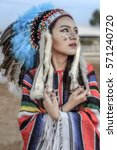 Small photo of American indian woman portrait outdoors