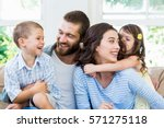 parents and kids sitting on... | Shutterstock . vector #571275118