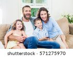 family and son sitting on sofa... | Shutterstock . vector #571275970