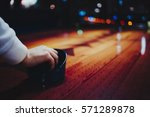hands of young people holding... | Shutterstock . vector #571289878
