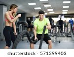 female personal trainer... | Shutterstock . vector #571299403