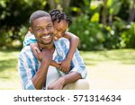 happy family posing together at ... | Shutterstock . vector #571314634