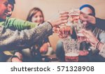happy friends toasting beers... | Shutterstock . vector #571328908