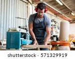 carpenter working on his craft... | Shutterstock . vector #571329919