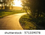 bicycle and walking path in park | Shutterstock . vector #571339078