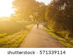 bicycle and walking path in park | Shutterstock . vector #571339114