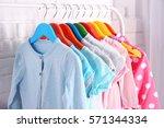 children clothing on hanger... | Shutterstock . vector #571344334