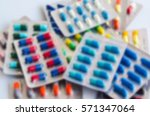 blurry antibiotic pills... | Shutterstock . vector #571347064