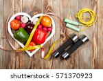 sport and diet. vegetables ... | Shutterstock . vector #571370923