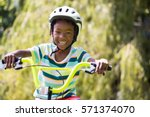 a sporty kid bike riding on a... | Shutterstock . vector #571374070